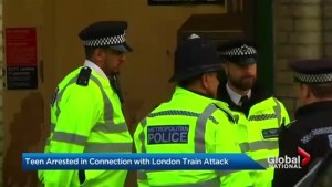 Police, soldiers reinforce security in UK after subway bombing attack